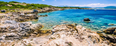Beautiful costline with granite rocks and amazing azure water on Porto Pollo, Sardinia, Italy Stock Photography