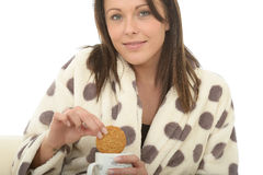 Beautiful Cosy Relaxed Happy Young Woman Enjoying Tea And Biscuits Stock Photos