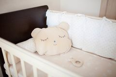 Beautiful cot with pillows royalty free stock images
