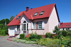 Beautiful cottage. Beautiful house with red roof royalty free stock images