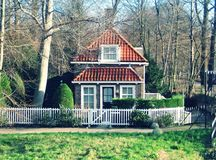 Beautiful Cottage. Tiny beautiful, tiny, fairy-tale cottage standing near the forest Stock Photography