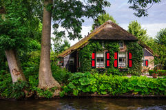 Beautiful cottage in Giethoorn. Giethoorn, also known as the Venice of Holland or the Venice of the North, is a beautiful village in the Netherlands Stock Photography