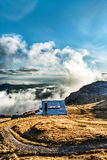 Beautiful cottage on a peak Stock Photos