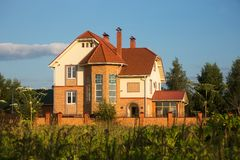 Beautiful cottage in summer rural landscape Royalty Free Stock Photo