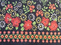 Black natural fabric with flowers. Beautiful cotton fabric with painted flowers , can use as background Royalty Free Stock Image
