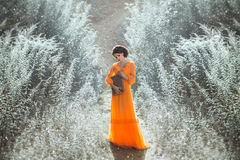 The beautiful countess in a long orange dress Royalty Free Stock Images