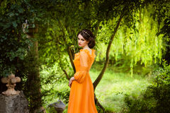 The beautiful countess in a long orange dress Royalty Free Stock Photos