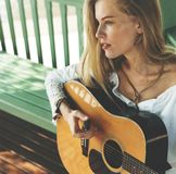 Beautiful country girl with her guitar stock images