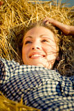 Beautiful country girl lying on the haystack Stock Images