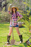 Beautiful country girl poses with a shovel Royalty Free Stock Photo