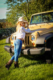 Beautiful Country Girl posing on a vehicle Royalty Free Stock Photography