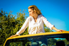 Beautiful Country Girl posing on a vehicle Stock Photo