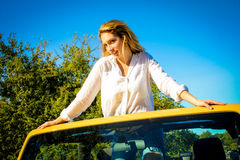 Beautiful Country Girl posing on a vehicle Stock Photos