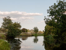A beautiful country scene of the stour river in dedham with tree. S reflected in the water; UK Royalty Free Stock Photos