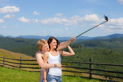 Beautiful country style dressed couple in love making selfie. Over mountain panorama royalty free stock image