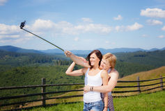 Beautiful country style dressed couple in love making selfie. Over mountain panorama royalty free stock images