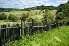 Beautiful countryside. Rolling hills, old wooden gate and a  meadow Royalty Free Stock Image