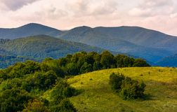 Beautiful countryside with forested rolling hills. Lovely Landscape of Carpathian mountains in early autumn season Stock Image
