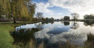 Beautiful countryside lake landscape on crisp Autumn morning Stock Photos