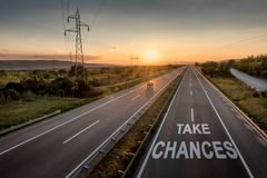Beautiful Motorway with a Single Car at sunset with motivational message Take Chances. Beautiful Countryside Motorway with a Single Car at sunset with stock photography
