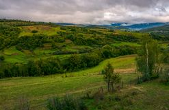 Beautiful countryside on an overcast day. Rural area of Carpathian mountains in autumn royalty free stock photos