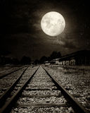 Beautiful countryside Railroad with Milky Way star in night skies, full moon Royalty Free Stock Photo