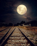 Beautiful countryside Railroad with Milky Way star in night skies, full moon Stock Photo