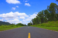 Beautiful countryside road under blue sky Royalty Free Stock Photo