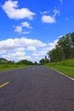 Beautiful countryside road under blue sky Royalty Free Stock Image