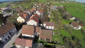 Beautiful countryside on a sunny day. Helicopter camera flaying over the village in the middle of a beautiful landscape on a sunny day stock video footage