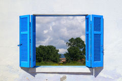 Beautiful countryside throught blue window Royalty Free Stock Photography