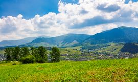 Beautiful countryside in transcarpathia at sunrise. Beautiful countryside of TransCarpathian town Volovets. spectacular early autumn scenery in mountains at Stock Images