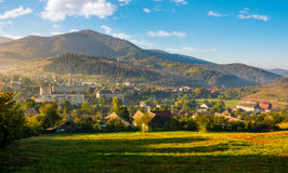 Beautiful countryside in transcarpathia at sunrise. Beautiful countryside of TransCarpathian town Volovets. spectacular early autumn scenery in mountains at Royalty Free Stock Images