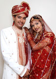 Beautiful Couple. A happy and beautiful Indian couple in their traditional dress at the time of marriage royalty free stock photo