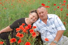 Beautiful couple. Portrait beautiful couple on the poppy field Stock Image