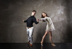 Beautiful couple in the active ballroom dance. On dark background Royalty Free Stock Photography