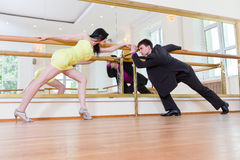 Beautiful couple in active dance, indoors Stock Photography
