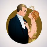 Beautiful couple in art deco style. Retro fashion: glamour man a Royalty Free Stock Photos