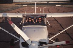 Couple in aircraft stock photo
