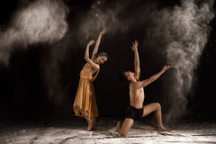 Beautiful couple ballet dancer with white powder explosion Royalty Free Stock Image