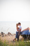 Beautiful couple on a beach. Near old boat Stock Images