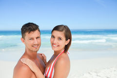 Beautiful couple at the beach. Beautiful couple on the beach and looking the camera Royalty Free Stock Photo