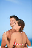 Beautiful couple at the beach. And looking happy Stock Image