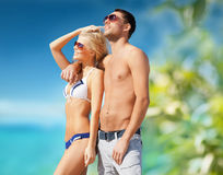 Beautiful couple on the beach. Summer holidays and vacation concept - happy couple on the beach Stock Image