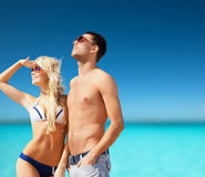 Beautiful couple on the beach. Summer holidays and vacation concept - happy couple on the beach Royalty Free Stock Photo