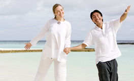 Beautiful couple at the beach Stock Image