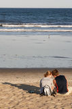 Beautiful couple on the beach. Near the ocean Royalty Free Stock Images