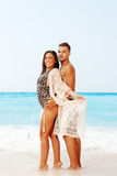 Beautiful couple at the beach. Portrait of a beautiful young couple at the beach Stock Photography