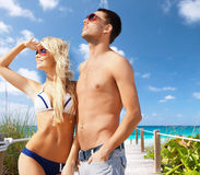 Beautiful couple on the beach. Summer holidays and vacation concept - happy couple on the beach Stock Images