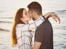 Beautiful couple on the beach. Summer, love. Attractive couple on the beach Royalty Free Stock Photos